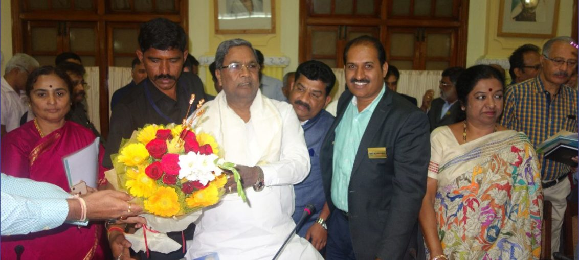 Karnataka Chief Minister & IAS Officer with PIA President